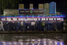 A wealthy sponsor provides free coffee, tea, and cookies to the the Jewish pilgrims to Rabbi Nachman's tomb. Approximately 30,000 religious Jews make an annual pilgrimage to the tomb of Breslover Rabbi Nachman's tomb in Uman, Ukraine for Rosh Hashanah. The pilgrimage is unique because it attracts men from across the spectrum of Judaism. In making the pilgrimage, they believe that Rabbi Nachman will intercede on their behalf on Yom Kippur, the Jewish day of atonement.