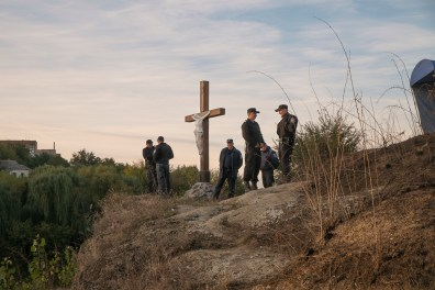 A group of locals have erected a crucifix at a popular prayer spot for the pilgrims. It is under police guard after having been destroyed in previous years. Approximately 30,000 religious Jews make an annual pilgrimage to the tomb of Breslover Rabbi Nachman's tomb in Uman, Ukraine for Rosh Hashanah. The pilgrimage is unique because it attracts men from across the spectrum of Judaism. In making the pilgrimage, they believe that Rabbi Nachman will intercede on their behalf on Yom Kippur, the Jewish day of atonement.