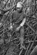 Elisa Castillo takes a break from picking shells in the Cayapas Mataje Mangrove Reserve. 2010.