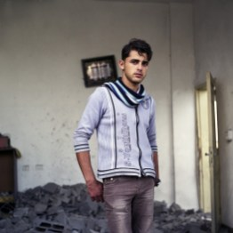 "Ahmed Zayed, an 18-year old fisherman in the rubbles of what used to be his home in Salateeh area, Gaza strip-hit in an israeli airstrike a few hours before the truce between Israel and Hamas after the 8-day operation Pillar of Defense. When asked about his future dreams and aspirations, he says: "" To live in peace and go to college""."