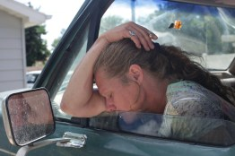 """""""You know what's nice"""" Charlotte asked, ?Being able to get in the car and go to the store...without asking."""" Here, Charlotte rests outside a shelter in Williston, North Dakota on August 26, 2013. Charlotte moved to Williston that winter to seek work with her ex-boyfriend. According to The National Coalition Against Domestic Violence, every 9 seconds in the US, a woman is assaulted or beaten. (Williston, North Dakota / August 2013)"""