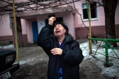 A Resident of Donetsk pleas before president Proshenko of UA to stop shelling Donetsk city, after shelling killed two civilians in her building block.