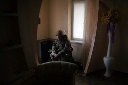A UA army soldier takes rest in a house that was destroyed by shelling, at the frontline city of Shastyia. the meaning of the name is : happiness
