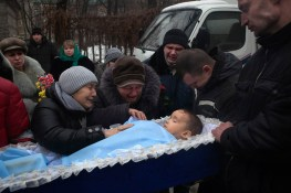 The funeral proccesion of Artyom Boboshian, Age 4, who was killed in an artillery strike at his home in Donetsk.