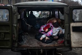 Bodies are being pilled up in the a morgue van after a mortar attack on a trolley bus in the city of Donetsk, which has left 8 people dead and many wounded.
