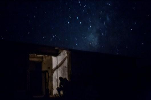 Punta Arena, Baja California, Mexico. A fisherman rests at night.