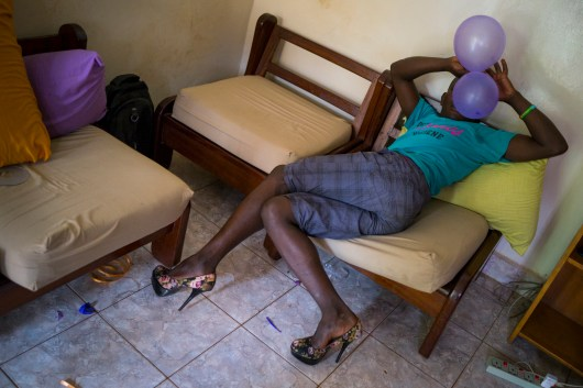 A transgender woman prepares for the festivities that evening. Kampala, Uganda. August 6, 2015. © Diana Zeyneb Alhindawi