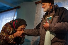 "Over the Orthodox Christmas holiday, or 'Old Christmas' as it is sometimes called, the local priest will travel to each home in the village and bless the residents. Pasha cries and kisses the priest's hand as he gives her a blessing. She gets very emotional when he visits, not only because she can realize her religious needs (which she cannot do socially due to her disability), but also because he is a relative of the family and she is happy to see him. Pasha is frequently moved to tears when she finally see's someone who has been away for a long time. When remembering Kazakhstan, Pasha remembers how both her culture and religion were taken away, ""… It was very hard and you are among strangers, you don't know when to celebrate Easter or Christmas, you long for your home, your sweet country, your most beloved country."""