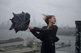 USA. Brooklyn, NY. 2015. Dasha Gavrylenko goes up on the roof of the 'kibbutz' appartment building to watch hurricane Joaquin.