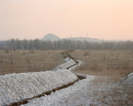 Trenches. The grounds of the Donbass region in Ukraine have big reserves and sources of coal, mercury and salt. All of the scenery is dominated by mining heaps and abandoned factories. Military forces are stationed in mine buildings. Hirs'ke, ATO zone (war zone), March 2015, Ukraine.