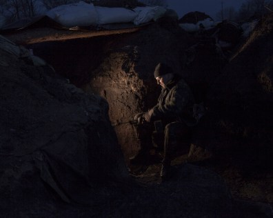 Soldier inside the trenches. ATO zone (war zone), March 2015, Ukraine.