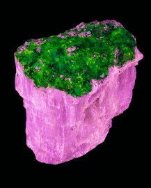 A Fluorescent Mineral lit by a short wave ultra violet fluorescent lamp. This process illuminates the mineral's natural color.(Agrelitepink, Thoritegreen)