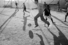Young men play soccer at the end of the day in Fazendinha Favela in Alemão complex. June 2014.