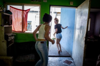Buenos Aires, Isla Maciel. K. and one of her younger sisters running out of their house.