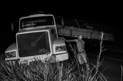 BRASIL NOVO, BRAZIL - JULY 26, 2014: A truck blocking the TransAmazonian Highway after an accident. The Transamazonian is a 4000km road across the Amazon rainforest started during the 1970′s under the Brazilian dictatorship. The construction of the TransAmazonian produced severe impacts on the rainforest environment, contributing to introduce drug and arms trafficking into the region.