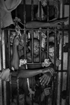 SANTA IZABEL DO PARA, BRAZIL - MAY 19, 2015: An overcrowded cell inside the triage facility of the Americano Penitentiary complex in Santa Izabel do Pará where 302 inmates share a space designed for 148 people. Cells designed to host 12 people end up containing more than 25 prisoners. Severe overcrowding is plaguing the Amazon region's penal system and it raises tensions inside the cells where is relatively easy for drug gangs to take control of the facilities.