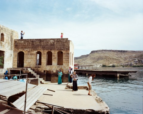 Local tourists visiting the village of Halfeti partly flooded by the reservoir lake of the Birecik Dam on the Euphrates river.The dam was built on top of the ruins of the ancient city of Zeugma. The inhabitants of Halfeti and Savaçan were displaced to the city of Karaotlak built by the Housing Development Administration of Turkey in 2000. Halfeti,Turkey