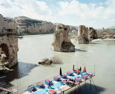 View on a terrace of a restaurant above the Tigris. The Old Bridge is a ruined four-arch bridge spanning the Tigris River in the town of Hasankeyf. It was built by the Artuqid Turkmens in the mid-12th century, between about 1147 and 1167, and at the time its central arch was one of the largest in the world, if not the largest. The town along with the bridge will be flooded by the Ilisu dam within the year 2018. Hasankeyf, Turkey