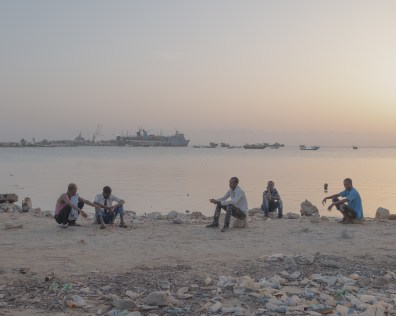 During Ramadan, young men sit on the banks of the Gulf of Aden in Berbera, Somaliland, waiting for breaking the fast at sunset. Somaliland's largest source of income comes from the port of Berbera. Somaliland mainly exports livestock to the Arab Gulf states.