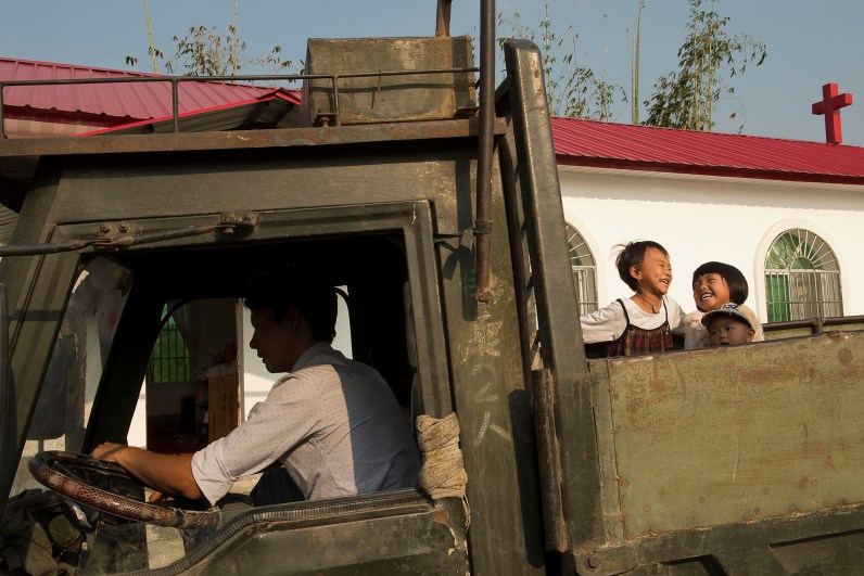 A man used his truck to fetch family members and friends to church each Sunday. In Yunnan's remote mountainous areas, villages are often located quite far apart. Simple vehicle such as this is used to take them to church for Sunday services every week. As many have to travel for quite a distance on dirt road in the mountains, they will usually stay the whole day in church on Sundays for fellowship and meals after the worship service.