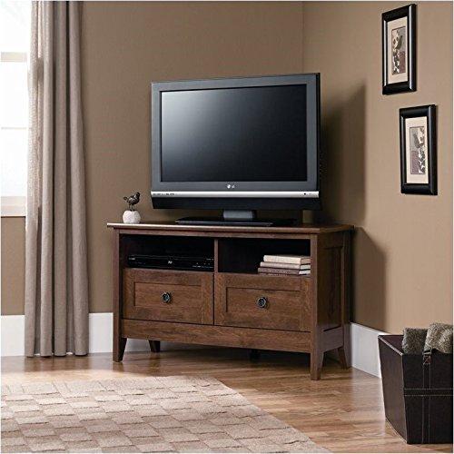 Pemberly Row Corner TV Stand in Oiled Oak