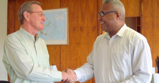 CDB's Bruce Mackinlay (left) with Michael Kaiser of founding member, Teachers Savings & Loan. Credit: CDB