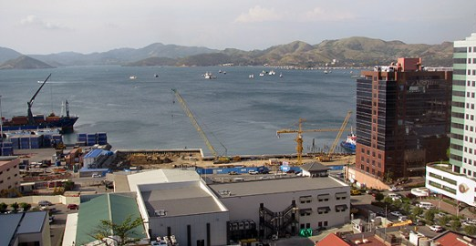 Port Moresby Harbour, viewed from 'Town'. Steamships' multi-storey office and marina development—which will open up the waterfront to the CBD for the first time—is under construction in the foreground.
