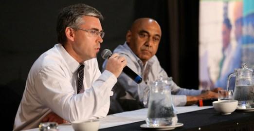 Digicel PNG's John Mangos (left) with Telikom PNG Chairman Mahesh Patel.