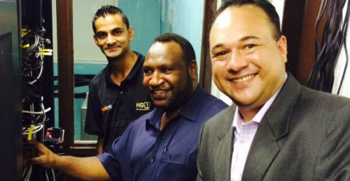 Click's Engineering Manager; Reenal Deo;  PNG's Minister for Finance James Marape and MD Richard Broadbridge.