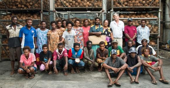 Directors Debra and Dennis Hill with the Niugini Organics team. Credit: Jody Cleaver.