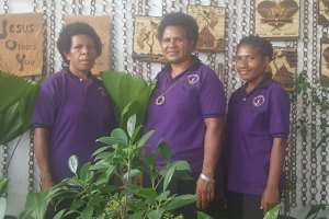 Tinah Kama with staff at Bill's Tropical Eden. Credit: The National