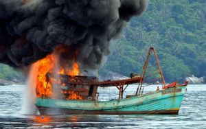 "PACIFIC PAPUA NEW GUINEA 18 Jan 2017 Sinking illegal 'blue boats' not enough of a deterrent - advisor 2:43 pm on 18 January 2017 Share this Share on Twitter Share on Facebook Share via email Share on Google Plus Share on Reddit Share on Linked In Blowing up, burning and sinking so-called Vietnamese ""blue boats"" for illegally fishing in some Pacific countries and Indonesia is not enough of a deterrent, a Pacific fisheries adviser says. This picture shows a Vietnamese fishing boat in flames after Indonesian Navy officers blew up the vessel due to illegal fishing activities in the remote Anambas Islands.A Vietnamese fishing boat in flames after the Indonesian military blew it up for fishing illegally. Credit: AFP"