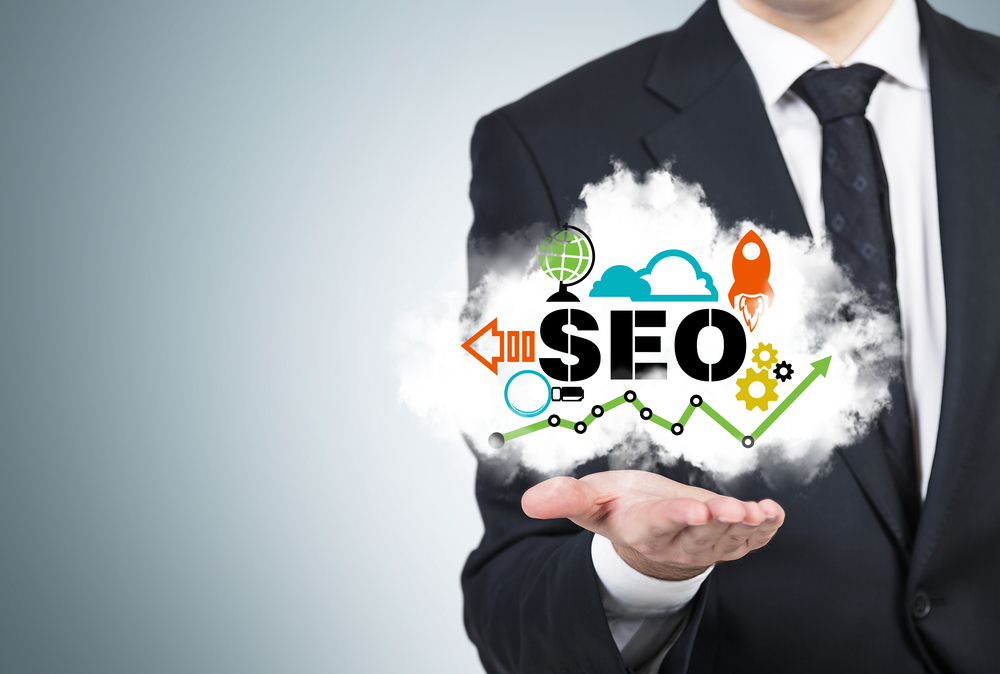 Businessman holding image with concept of SEO