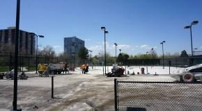 Gates Tennis Center cracks open first phase of court refinishing