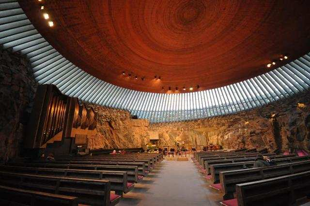 Built into subterranean rock, the Temppeliaukio Church in Helsinki boasts a glazed dome just above ground level that lets ample sunlight into the interior. Those rough rock walls were left untouched by the designers for a reason: naturally great acoustics make the church a perfect venue for concerts.