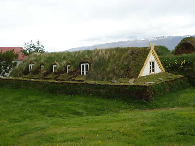 "This home in Glaumbær, Iceland is an example of a ""turf house""— a highly-insulated building that has a stone foundation and layers of turf built around the sides."