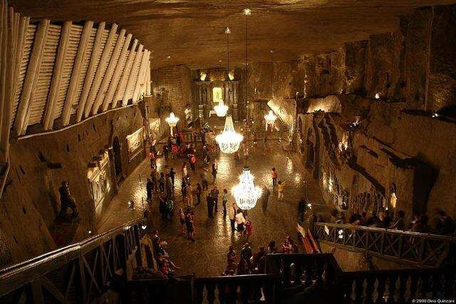 In Poland, 800 steps lead down a shaft to this space, which holds an art gallery, health resort, and massive halls that host weddings and conferences. This 13-century marvel was once a salt mine.