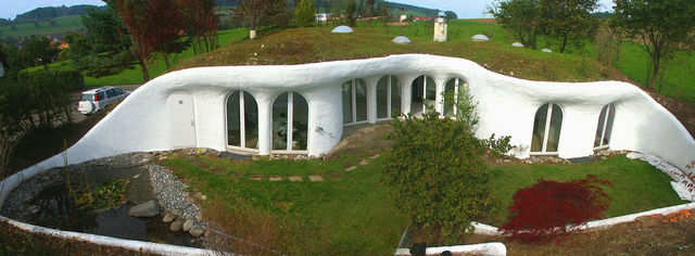 "Created by architect Peter Vetsch, this Swiss home is an example of an ""earth house"" — a type of home built into the ground that relies partially on surrounding terrain for walls."