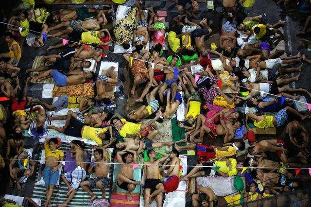 Filipino President Duterte's bloody war on drugs made headlines throughout the year. Since coming to power, Duterte has condoned the murder of more than 5,500 people suspected of either taking or selling illegal drugs. Those that aren't killed are sent to overcrowded prisons like the Quezon City Jail in Manila, pictured below. According to CNN, a large majority of inmates are in for drug-related offences.