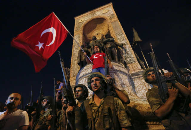 "In July, an attempted military coup by a faction within the Turkish armed forces calling itself the ""Peace at Home Council"" was stifled in less than 24 hours, after Turkish president Recep Tayyip Erdogan called on his supporters to take to the streets and repel the uprising. This photo shows Turkish military standing in front of the Republic Monument at the Taksim Square in Istanbul."