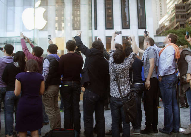 "An excited media dubbed it the ""Jesus Phone."" Excited fans camped out in front of Apple Stores nationwide."