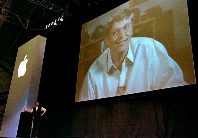 On July 4, 1997, Jobs persuaded Apple's board to oust Amelio and make Jobs the interim, and then permanent, CEO. In August 1997, Jobs took the stage at another Macworld Expo to announce that Apple had taken a $150 million investment from its long-time rivals at Microsoft.