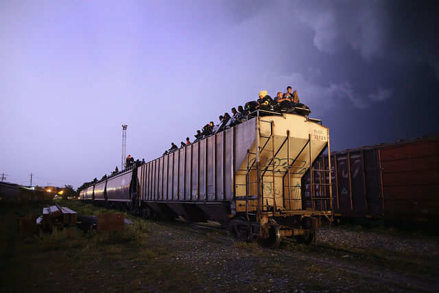 Some immigrants have attempted to cross the border into the US by riding atop freight trains, as seen in this 2013 photo. The journey is dangerous — immigrants risk robbery, assault, and injury from falling off the trains.