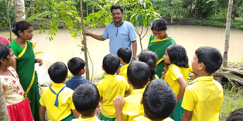 Biplab interacting with some children.