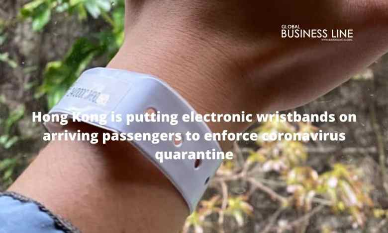 Hong Kong is putting electronic wristbands on arriving passengers to enforce coronavirus quarantine