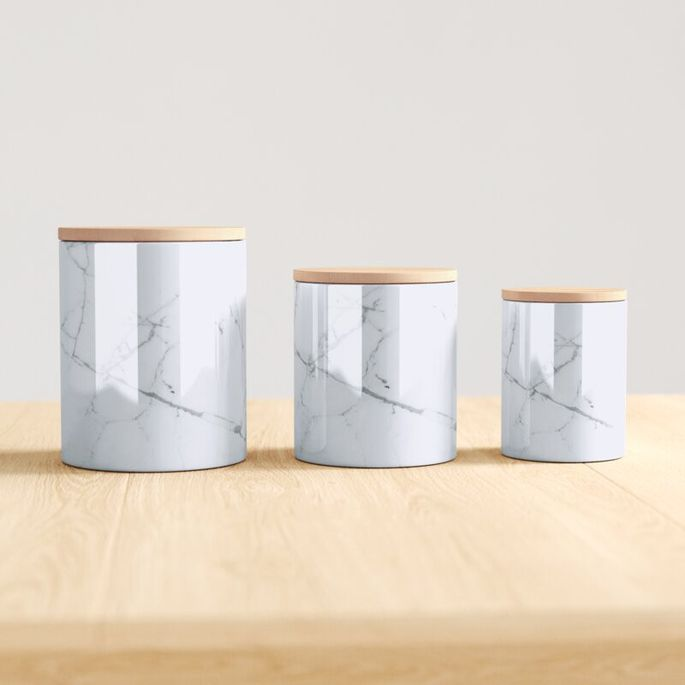 Store coffee, tea bags, and sugar in these faux marble containers