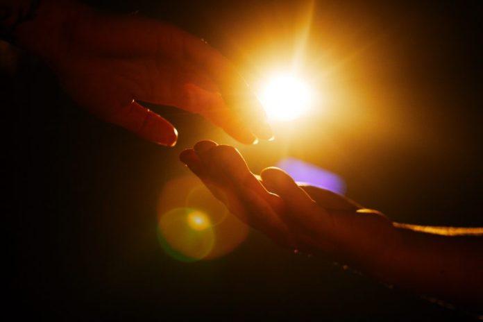 Hand touching under Urban Sun
