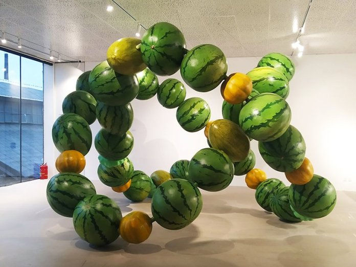 cyril lancelin explore data and nature abundance in an immersive sculpture made of giant melons in beijing 3