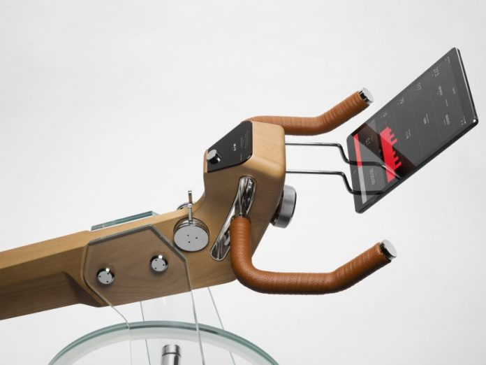 Close-up of exercise bike with leather handles and smart screen by Elite