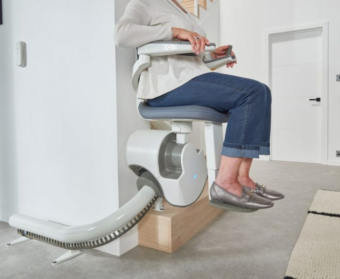 Close-up of person sitting in Flow X stairlift
